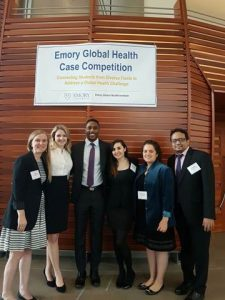 Student team pictured under banner at Emory University