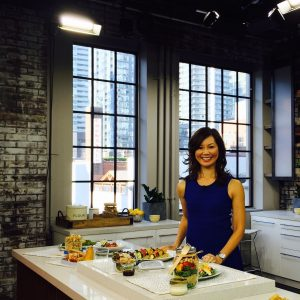 photo of Sue Mach in kitchen with healthy foods