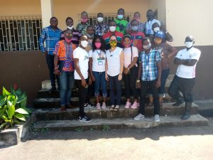 Ashley Aimone pictured with survey team in Sierra Leone pictured standing on steps infront of a building