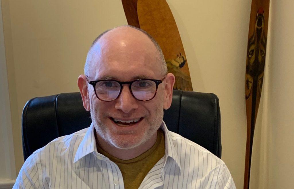 Neil Seeman head shot, glasses, white collared shirt