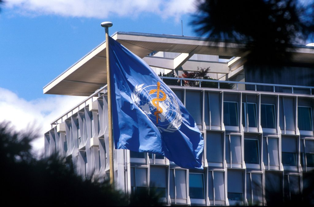 WHO headquarters with WHO flag